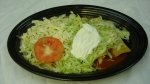 Enchiladas Supreme - Cheese, chicken, beef and bean enchiladas topped with lettuce, tomatoes and sour cream.